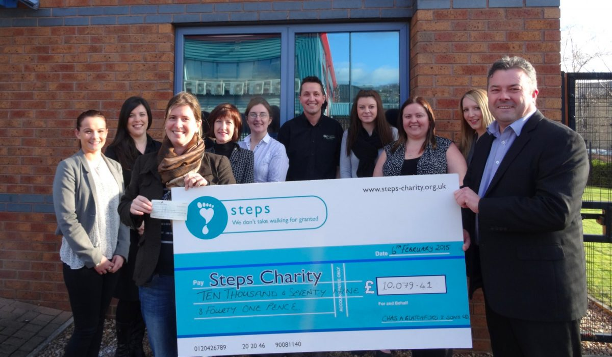 Steps charity receives cheque for £10,079 from Blatchford